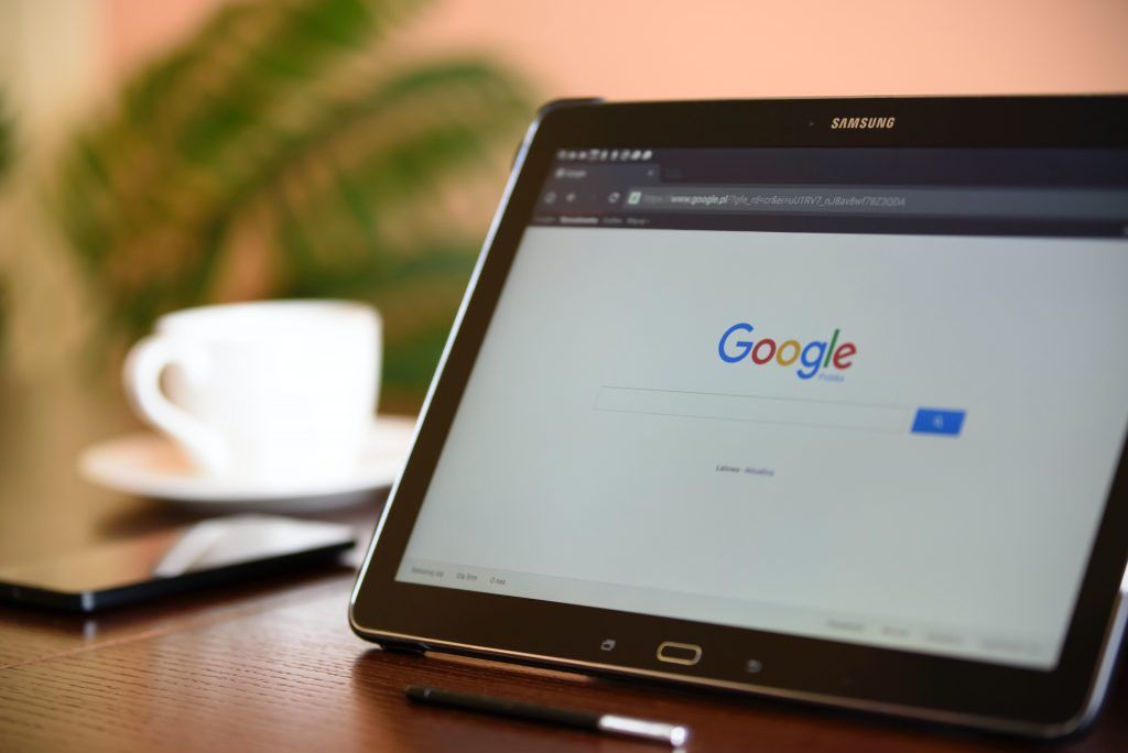 black tablet showing a google page